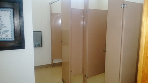 Womens bathroom, 3 stalls, 1 sink, & baby changing table