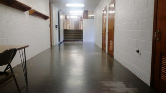 N/S hallway with bathrooms, Gym view to the kitchen seating area