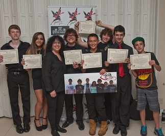 Teen band Zofolk, receiving Community Service Award Certificates at  The 1st Annual STRONG BEACH® Battle of The Bands, 2014