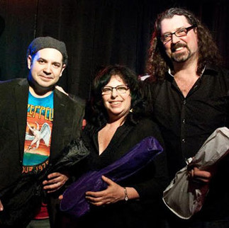 Joanne J-Bird Phillips donates new instruments to Orchestra Co-Directors Jeff Alan & Benjamin Metzger  of The Long Beach Ukulele Orchestra, on behalf of J-Bird Music for The Arts, Inc. 3/26/2015