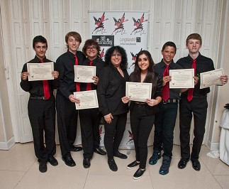 Teen band Katie Zimmer & The Rock-n-Roll University Allstars, receiving Community Service Award  Certificates at The 1st Annual STRONG BEACH® Battle of The bands, 2014