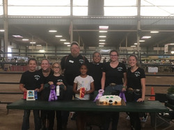 Grand Champion and Reserve Champions celebrating with cake
