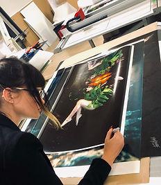 Beth Mitchell signing underwater print