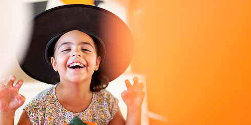 close-up-portrait-happy-small-child-wearing-witch-hat-blurred-background-lots-space-text.j