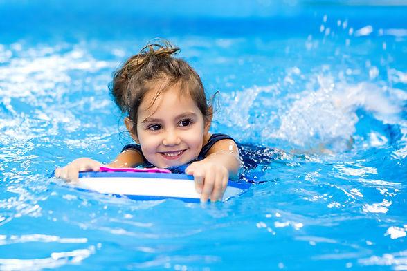 little-girl-learning-swim-pool.jpg