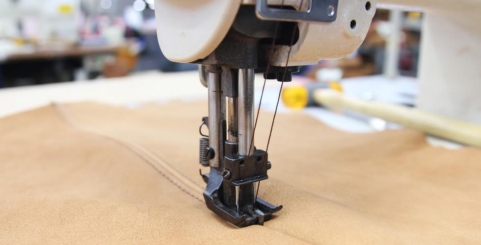 Closeup of sewing machine working part w