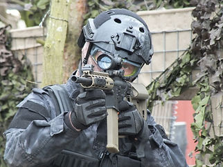 AIRSOFT SKIRMISH PLAYER WITH M4 AT BATTLE STATIONS AIRSOFT