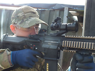 CLOSE UP AIRSOFT SKIRMISH PLAYER USING A HK AT BATTLE AIRSOFT CQB CENTRE