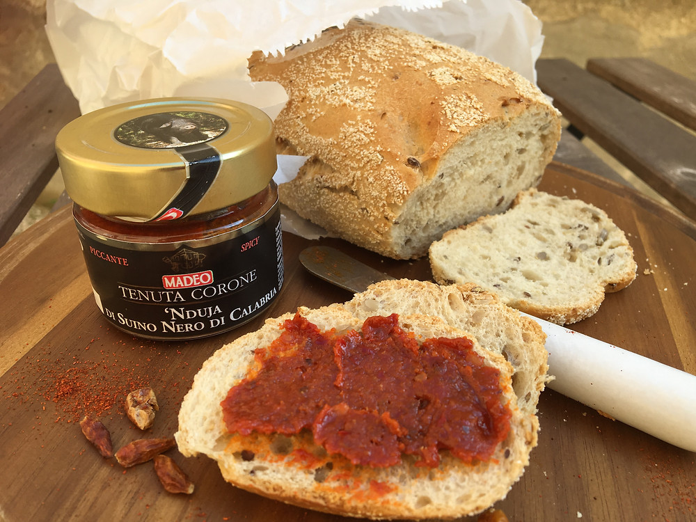 'Nduja, spread on a slice of bread.