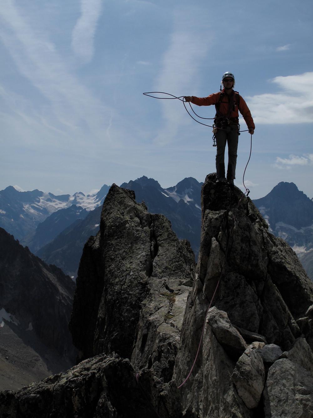 Climber on peak, Aiguilles Rouges