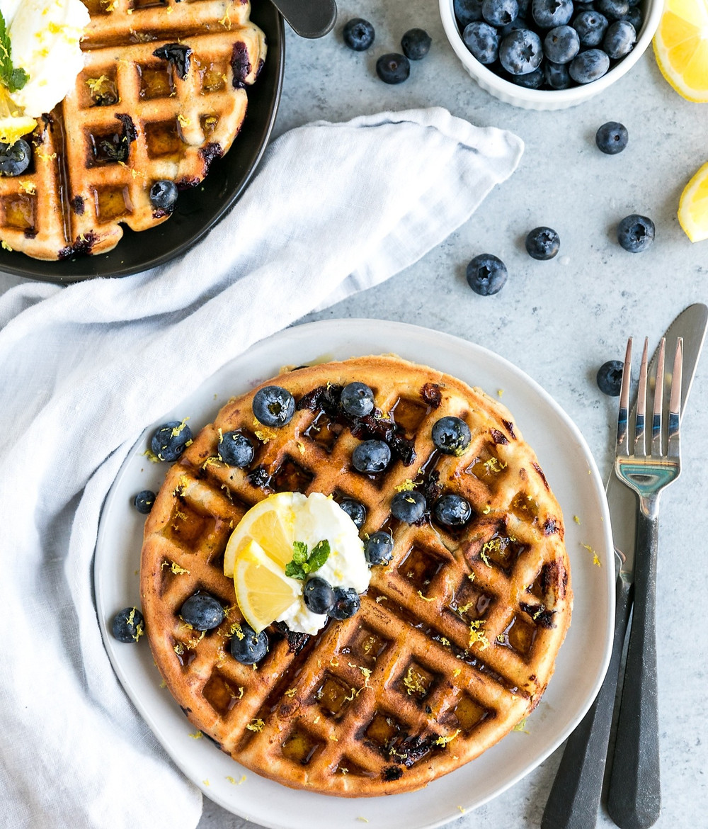 Light, fluffy waffles with blueberries and lemon zest.
