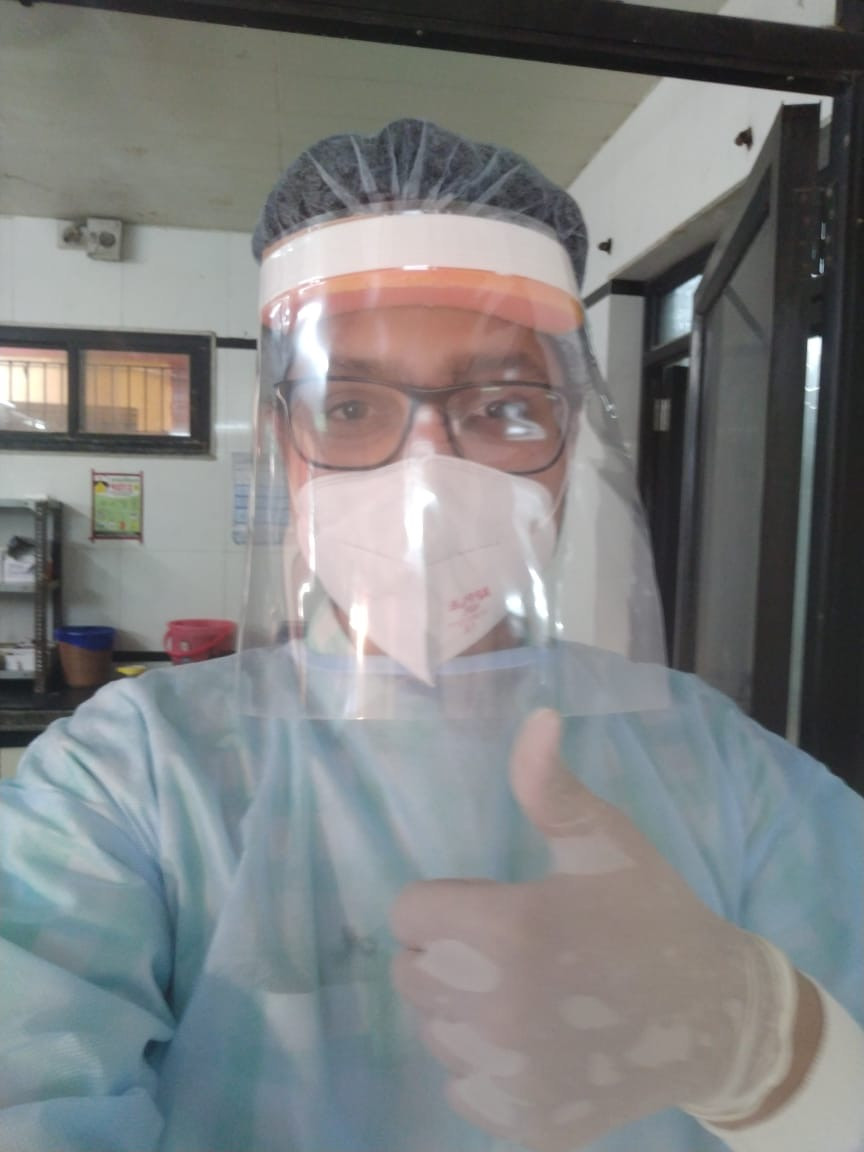 Dr. Poojan Shah on duty wearing PPE suit