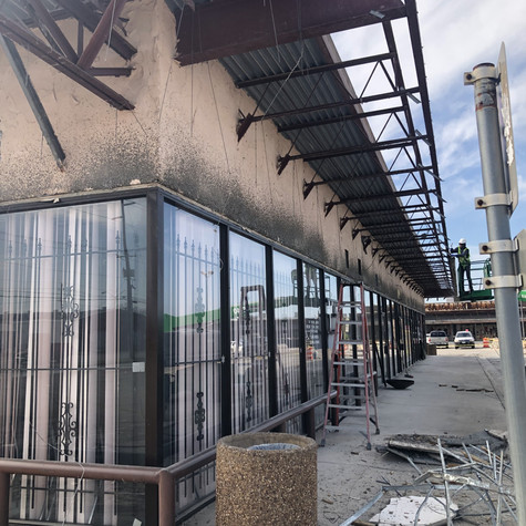 Store front demo after - Denton Conns