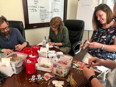 Volunteers make ornaments