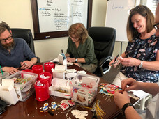 Volunteers make ornaments