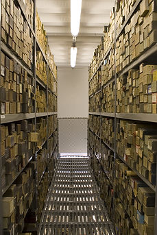 Inside of the roll library, showing hundreds of rolls in rows on two sets of shelves.