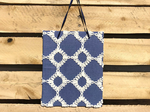 Blue and white patterned wall fabric art
