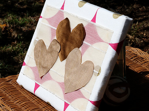 Heart Series: Pink and white circled canvas with three hearts