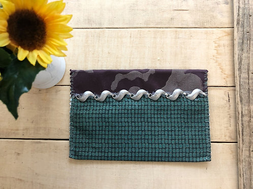 Purple and teal patterned small bag