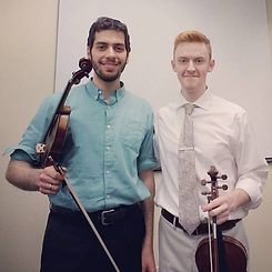 proud violin teacher with his student