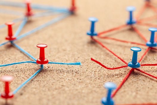 Business team. The gap is due to contact between people. Office pins linked by blue thread
