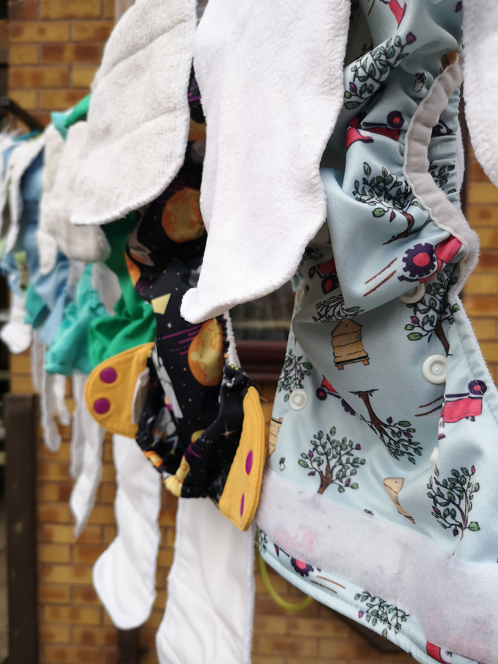 Tickle Tots reusable cloth nappy drying outside