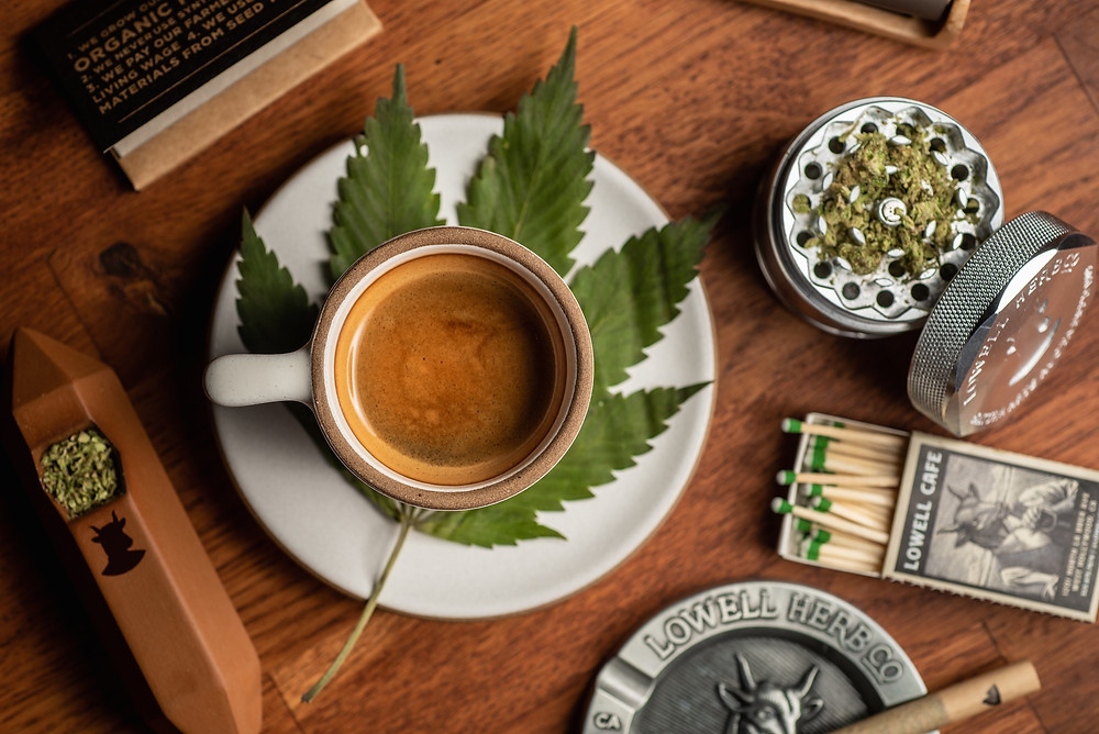 coffee sitting next to a cannabis grinder