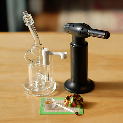 dab rig, wax, container, and torch