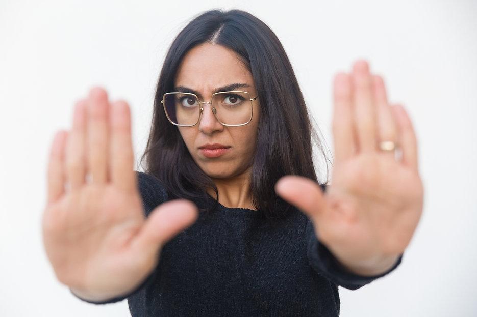 scared-upset-woman-making-stop-gesture.j