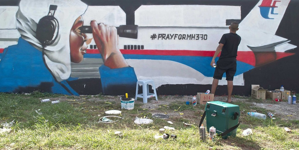 graffiti-artist-paints-mural-in-tribute-to-mh370-passengers2c-data-1024x515.jpg