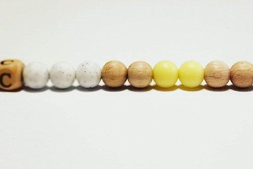 Attache-suce jaune et blanc