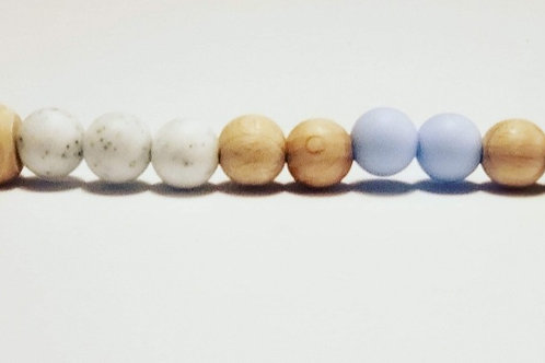 Attache-suce bleu et blanc