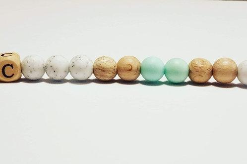 Attache-suce turquoise et blanc