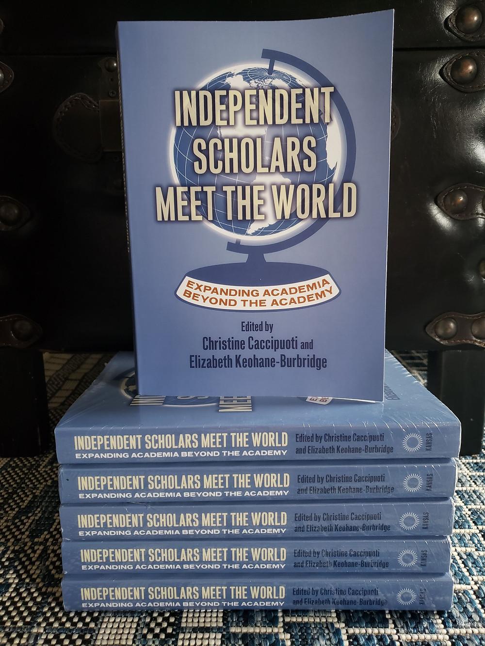 Display of stacked copies of Independent Scholars Meet the World