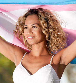 A background image, featuring a transgender woman holding a transgender flag.