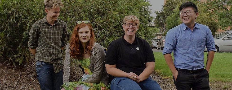 A banner image showing team members of Trans Health Research, smiling outside.