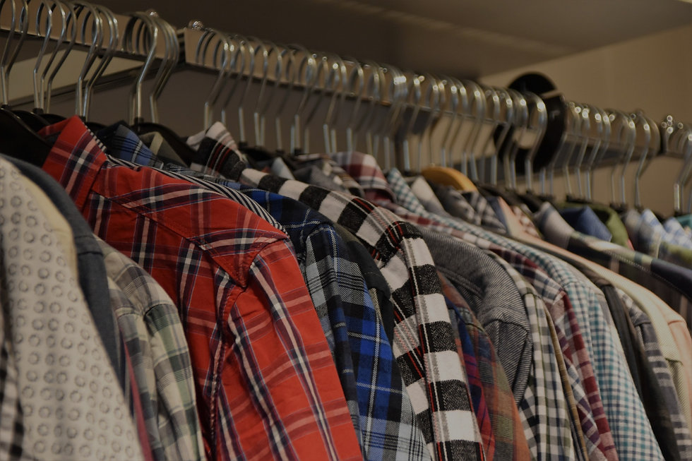 A background banner image showing a hangar of shirts.