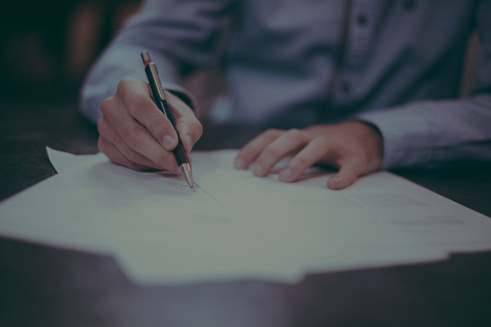A banner background image featuring a person writing in a legal document.