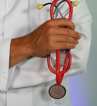 A background image featuring a medical professional holding a stethescope.