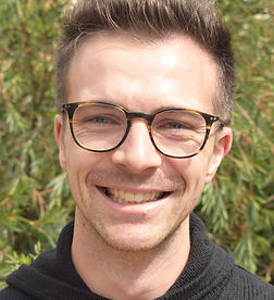 A photograph of Dr Brendan Nolan. He is wearing glasses and smiling.