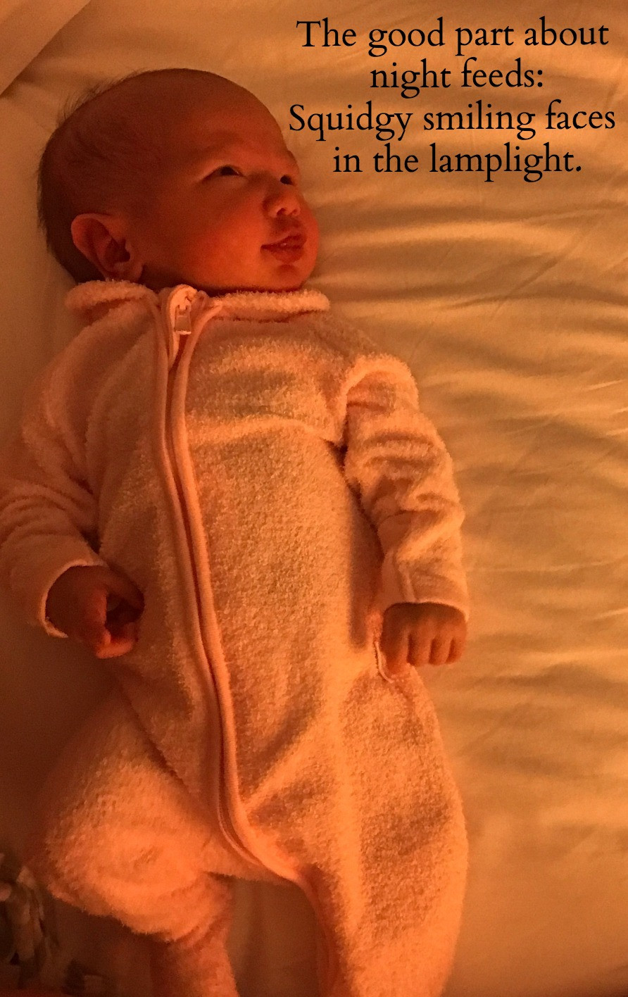 The good part about night feeds - squidgy faces smiling in the lamp light.