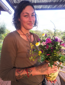 stef with flower display for lunch table