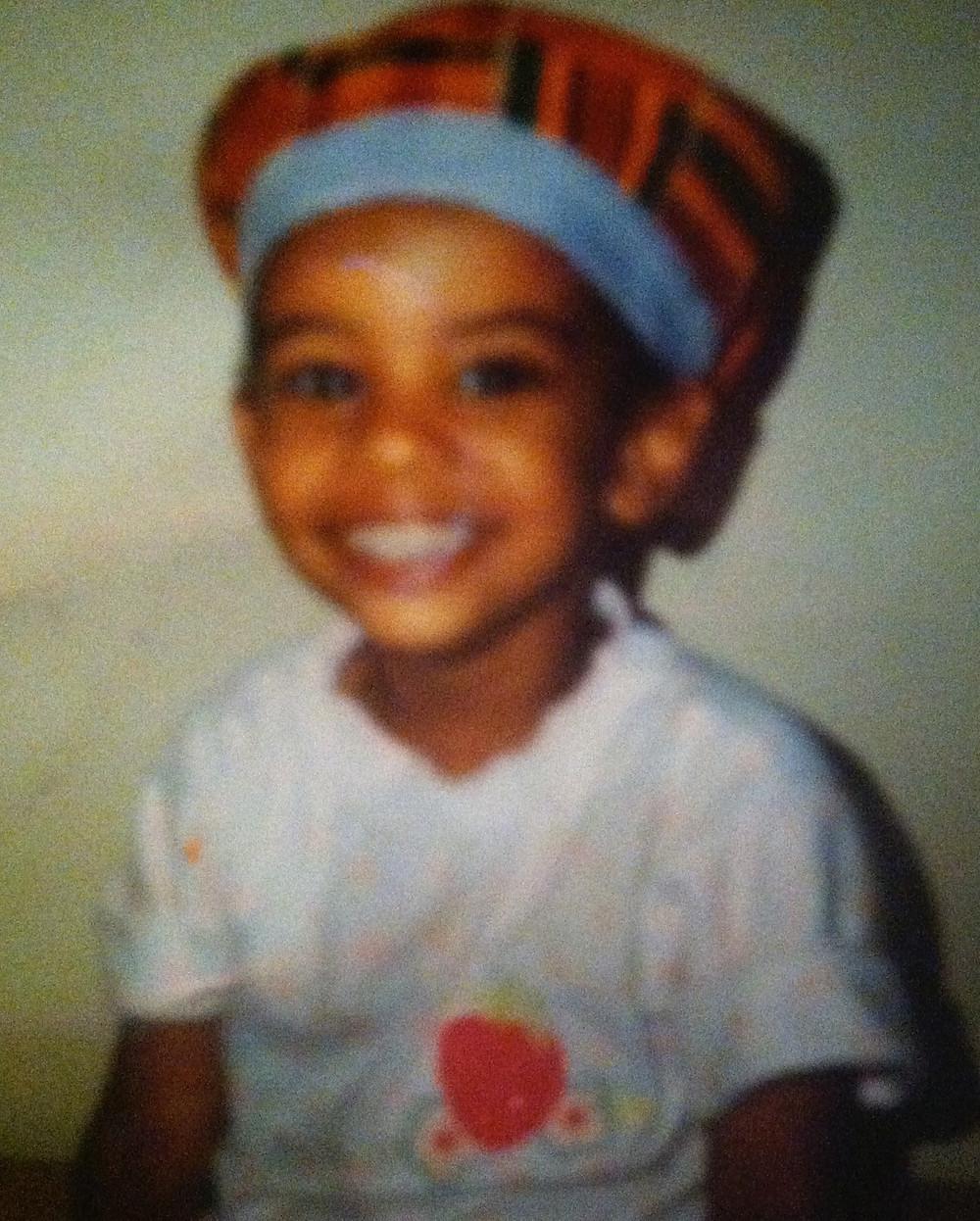 Baby ShanMichele wearing a Kente Cloth hat