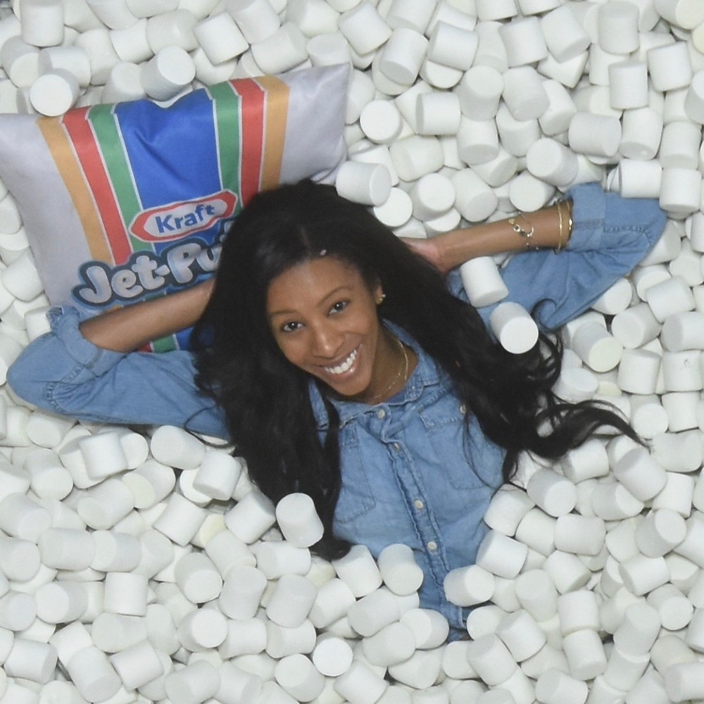 ShanMichele in the Jet-Puffed marshmallow pit at Candytopia.