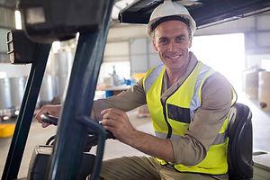 portrait-of-happy-worker-driving-forklift-2021-04-04-18-02-27-utc.jpg
