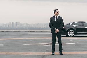 serious-bodyguard-standing-with-sunglasses-and-sec-2021-04-06-13-44-21-utc.jpg