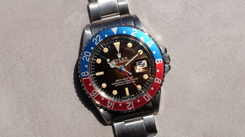1966 Rolex GMT Master Ref. 1675 'Glossy Gilt Tropical dial'