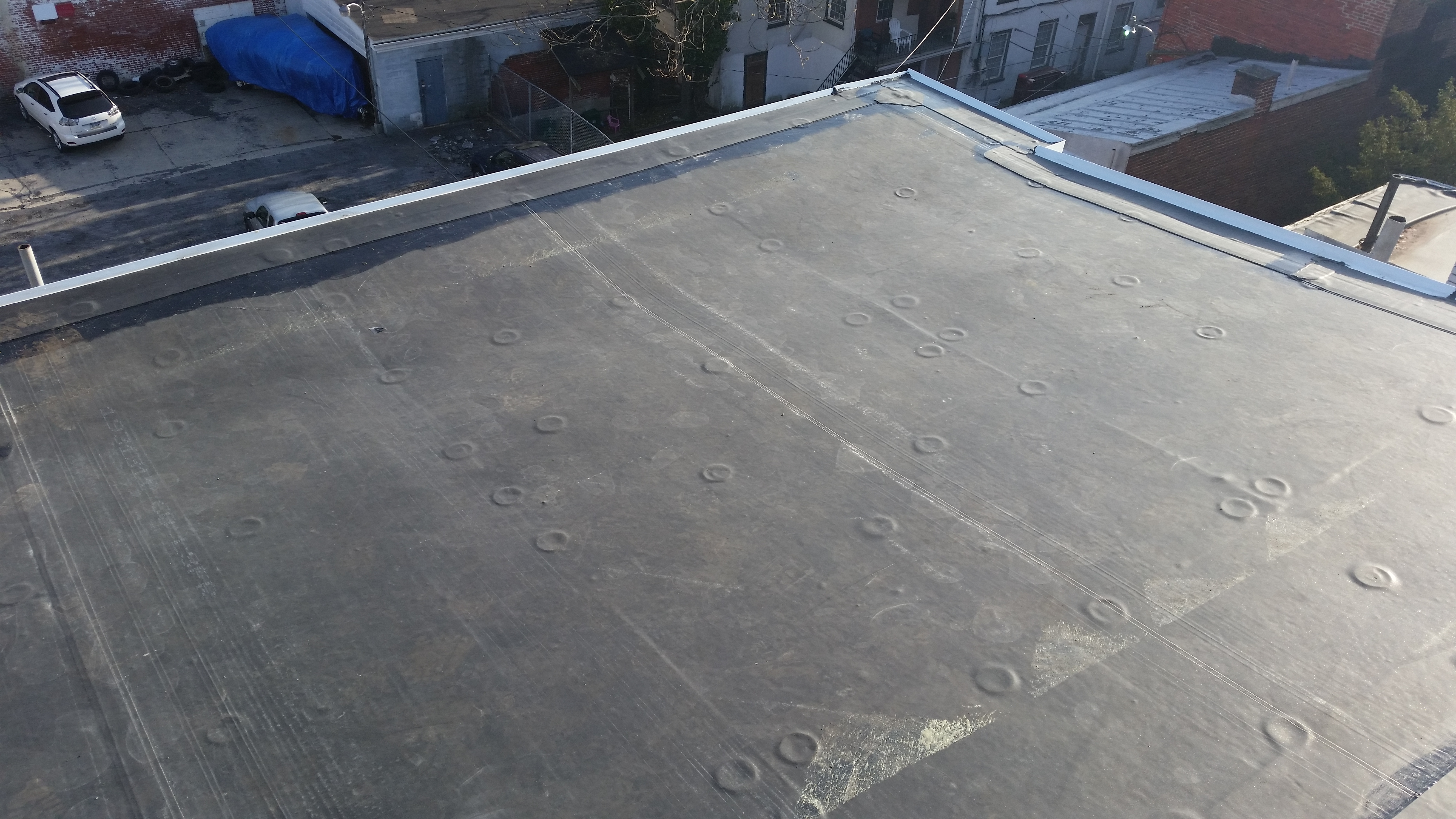 replace rubber roof in Philadelphia
