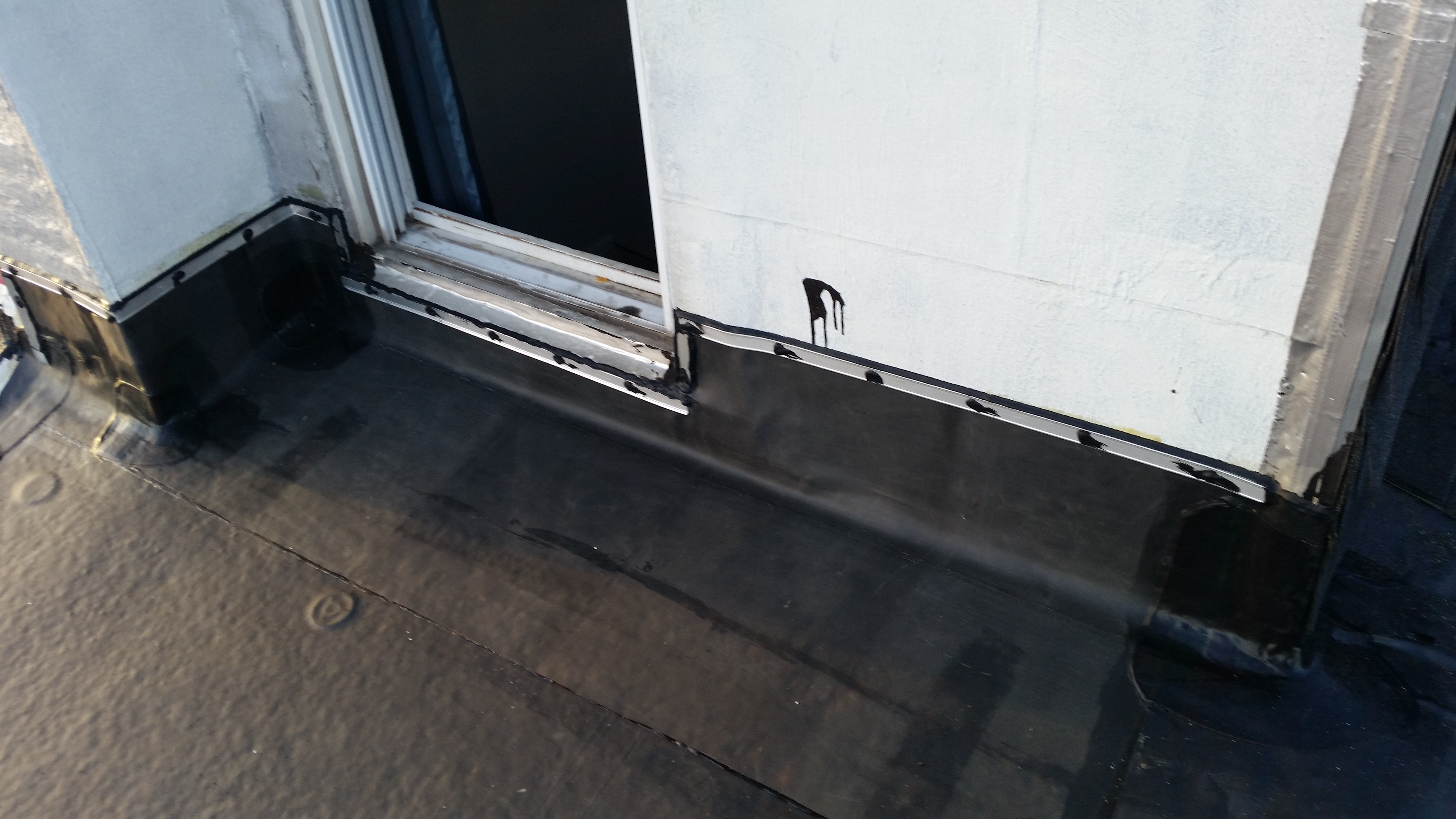 termination bar and rubber roofing