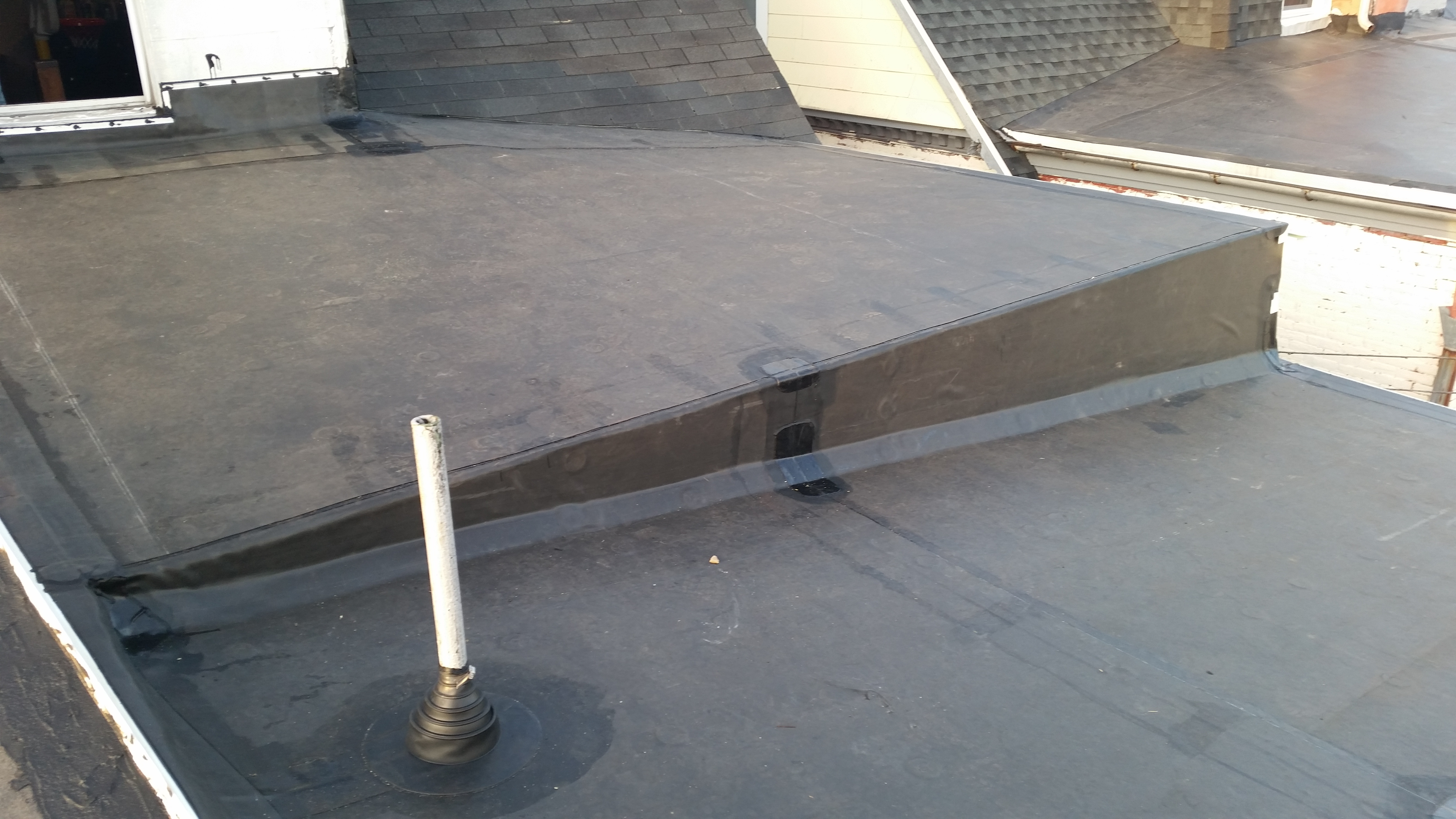 two rubber roofs replacement